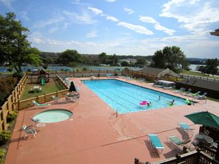 Moneta condo photo - Olympic size pool, baby pool, and playground with lake and mountain views