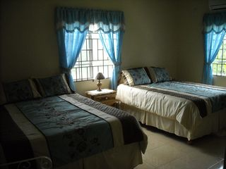 Ocho Rios house photo - Second bedroom with two queen size beds private bathroom and walk-in closet