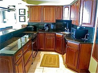Deerfield Beach condo photo - fully stacked kitchen with stainless steel appliances