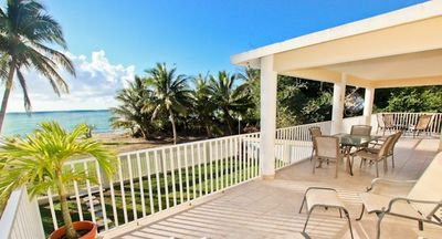 Extensive 2nd level porch/balcony overlooking your sandy beach
