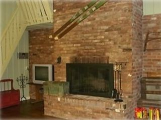 Windham chalet photo - Brick floor to ceiling wood fireplace to keep cozy