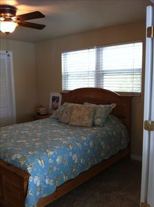 bed room with queen size bed and walk in closet.