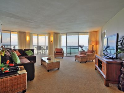 A large wrap-around lanai, accessible from the living room and master bedroom,