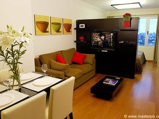 Palermo apartment photo - Living room has a sofa bed and the TV/Mirror swivels so you can watch here too