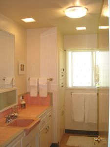 One of two spacious, charming bathrooms.