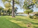 Yard - Take off your shoes and enjoy the grassy lawn overlooking the lake.