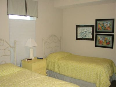 Guest bedroom has 2 twin beds