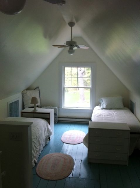 upstairs bedroom, 2 trundle beds, sleep four max, 1/2 bath, tv with vcr, dvd