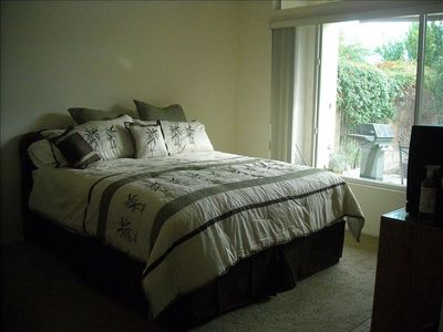 King size master bedroom, 2 walk-in closets, television, writing desk.