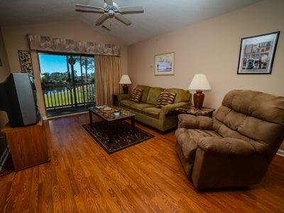 Hardwood floors and balcony access in living room