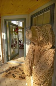The friendly Bear is welcoming you and your family at the front door.