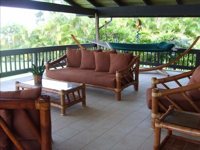 Relax on our Spacious Lanai with Plush Bamboo Furniture and Hammock