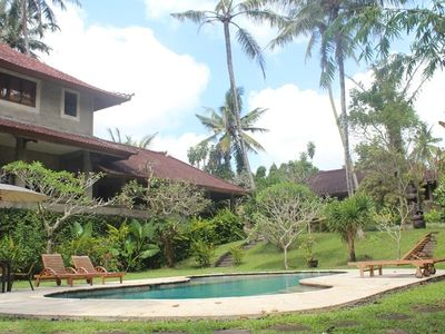 Villa's main building with kitchen, overlooking the pool