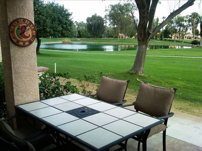 Large patio table with 4 padded chairs and views of the 9th and 18th fairways.