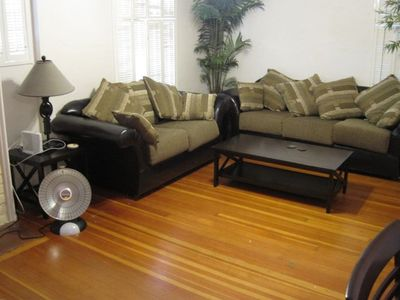 Large open living room with two foldout couches, one a full and the other a twin