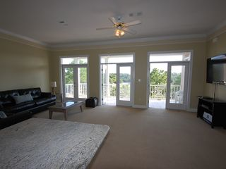 Fort Morgan property rental photo - The living room features a sleeper sofa and great views onto the balcony.