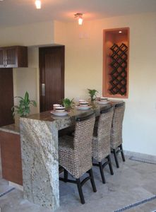 Granite breakfast bar facing kitchen
