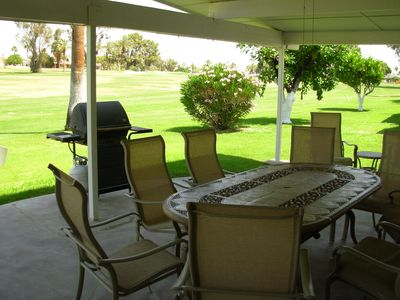 Patio table & gas BBQ with fairway view