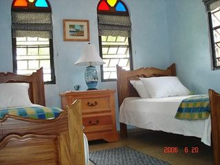 Rincon villa photo - Comfortable, airy BR w two twin beds, A C & fan