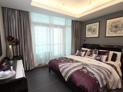Dubai Marina & Al Sufouh apartment rental - King sized bedroom with balcony with views to sea