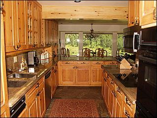 Vail house photo - New Granite Countertops Pine Cabinets