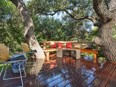 Enjoy the deck with plenty of bench seating and room to hang two hammocks.