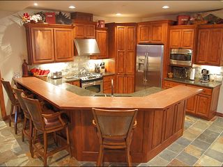 Big Sky house photo - Large Exquisite Kitchen, Fully Equipped for preparing Gourmet Meals.