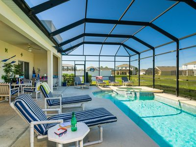 Large pool deck has plenty of space for all the family to relax and play!