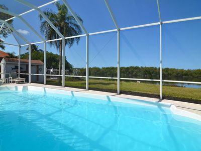 Very large solar-heated pool makes for a real Florida vacation. Let's go swim!