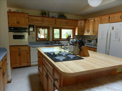 Large kitchen with 2 sinks, 2 disposals and many work areas