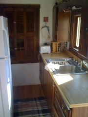 Michigamme River cabin photo - This Island galley kitchen has both a new,l full refrigerator and a stove/oven