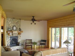 "Cedar Lake cabin photo - Main Floor Living Room. Fireplace Doors to Deck and Lake View. 32"" T.V."