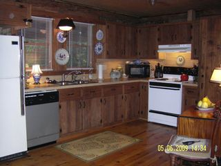Meadows of Dan cabin photo - Open Kitchen with Wormy Chestnut Cabinets