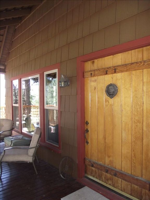 Built in 1945, a large wooden door creates a dramatic entrance.