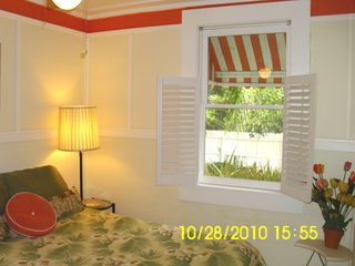 Full bed, plantation shutters, tongue & groove wood ceiling with fan - Tybee Island cottage vacation rental photo