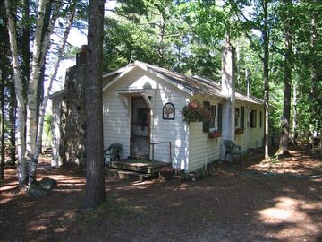 East Jordan cottage rental - The White Cottage is nestled in the woods and on the shore of Lake Charlevoix.