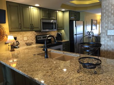 Newly remodeled kitchen with custom cabinets/ granite countertops. Beautiful!