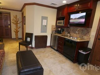 Park City condo photo - Living area with queen sofa bed, flat screen TV, fully equipped kitchenette