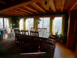 Chilmark farmhouse photo - The dinning room is adjacent to the kitchen bar area and has fr. doors to the LR