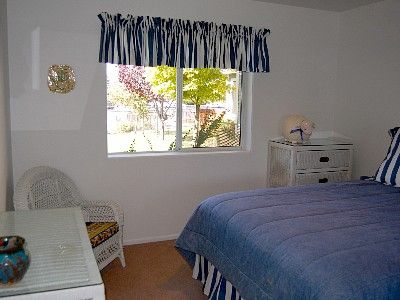 Tahoe Keys house rental - Queen bedroom w/ Mt. Tallac and water view. Desk and chair.