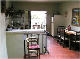 Second floor dining room,kitchen, and outdoor balcony  overlooking pond