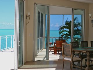 Providenciales - Provo villa photo - Screened porch for those few nights the tradewinds don't blow and bugs do!
