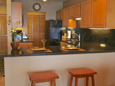 Enjoy dining at the breakfast bar in this open plan, ocean view kitchen.