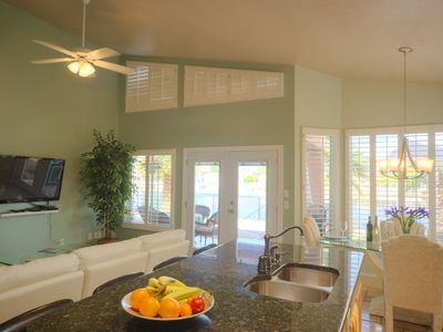 Kitchen/Family room with view of lake and 50 inch flat panel tv with blue ray.