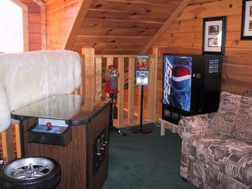 Loft area with a pull out sleeper, PacMan Game and snacks