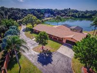 NEWLY RENOVATED HOME Lake Front, Gated, Private Home. Just 5 miles to the Beach!