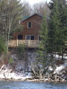 Grayling lodge rental - View of the deck from the magnificent Au Sable River!