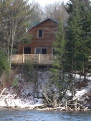 Grayling lodge photo - View of the deck from the magnificent Au Sable River!