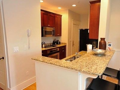 Fully stocked kitchen with granite & stainless steel appliances