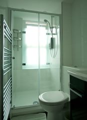 City of London apartment photo - Stylish Walk In Shower & Toilet